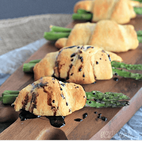 Asparagus Rollsups with a balsamic reduction drizzle