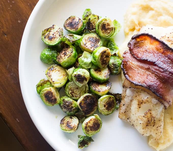 Bacon wrapped cod with celery root and apple puree