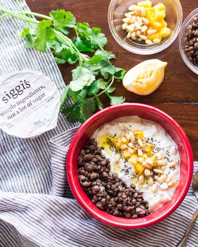 Savory breakfast bowl mango cucumber raita with lentils