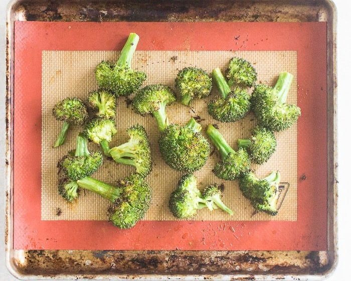 broccoli florets on a silicone baking mat