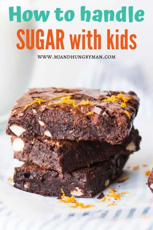 three stacked fudgy brownies with orange zest