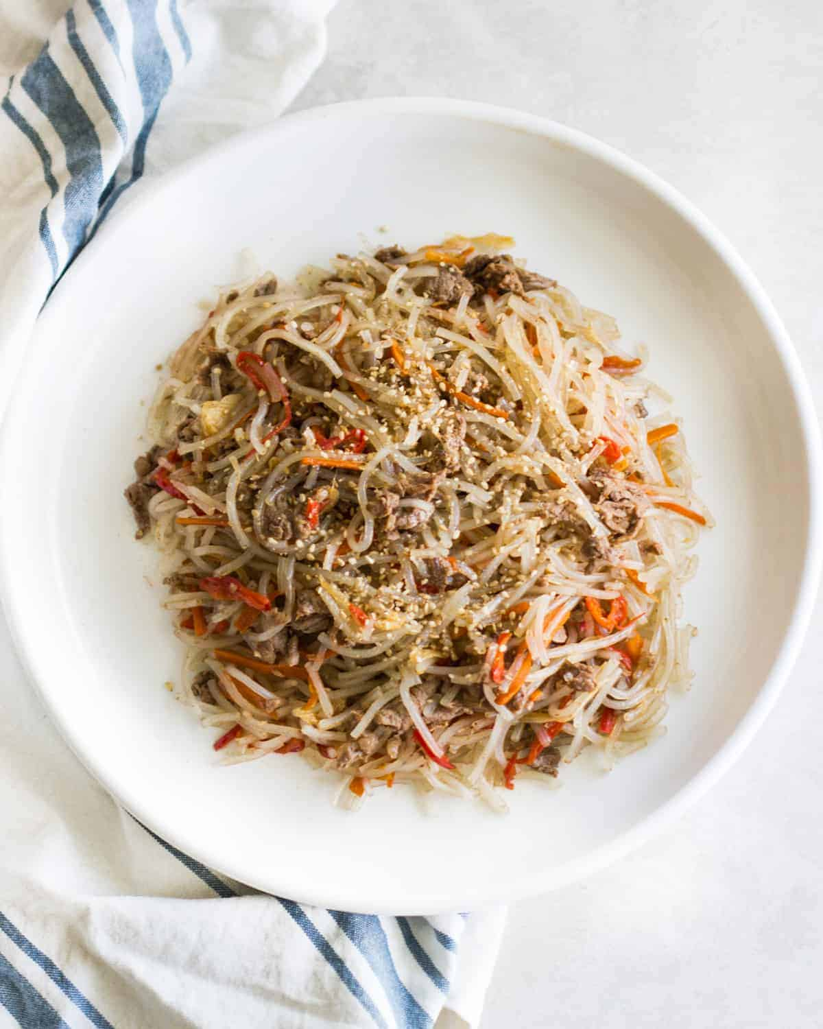 a close up shot of the plate baby-friendly japchae on a white plate