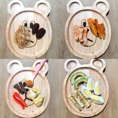 4 bear wooden plates with two to three different finger shaped foods for babies just starting solids