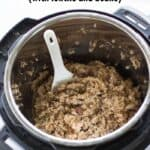 cooked multigrain rice inside the Instant pot with a spatula