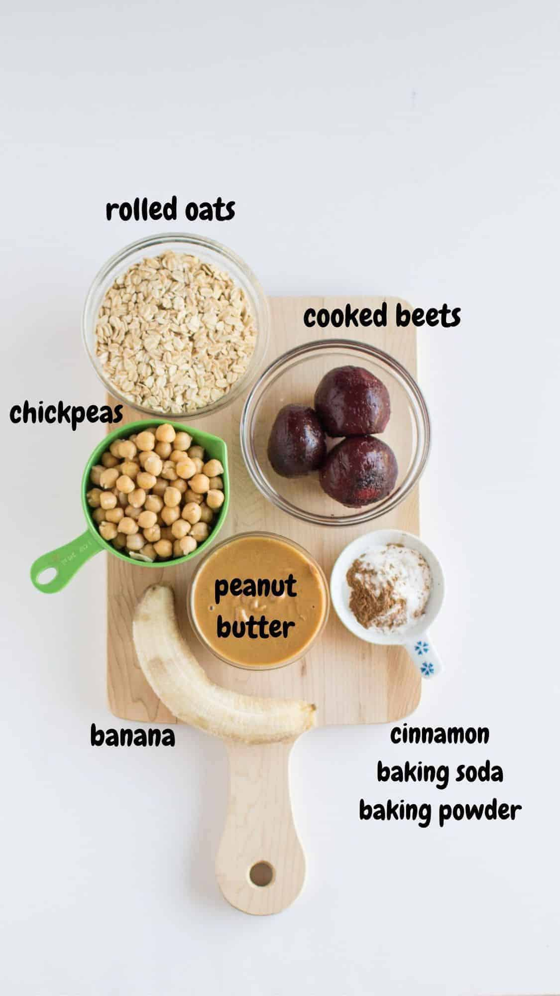 oats, beets, chickpeas, peanut butter, banana, cinnamon, on a wooden board