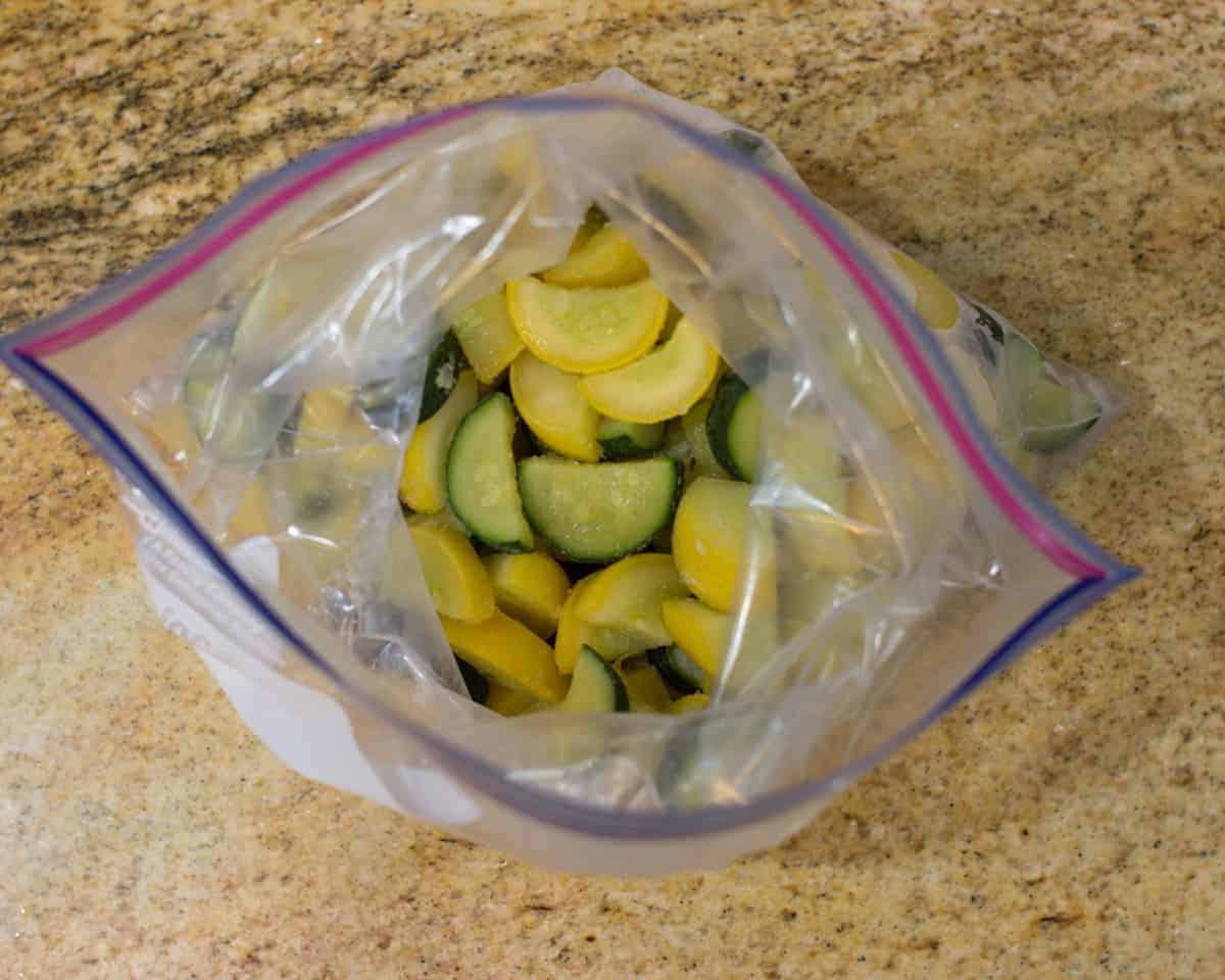 frozen zucchini inside a freezer safe bag