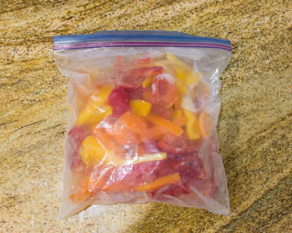 yellow red and orange bell peppers stored inside a freezer safe bag
