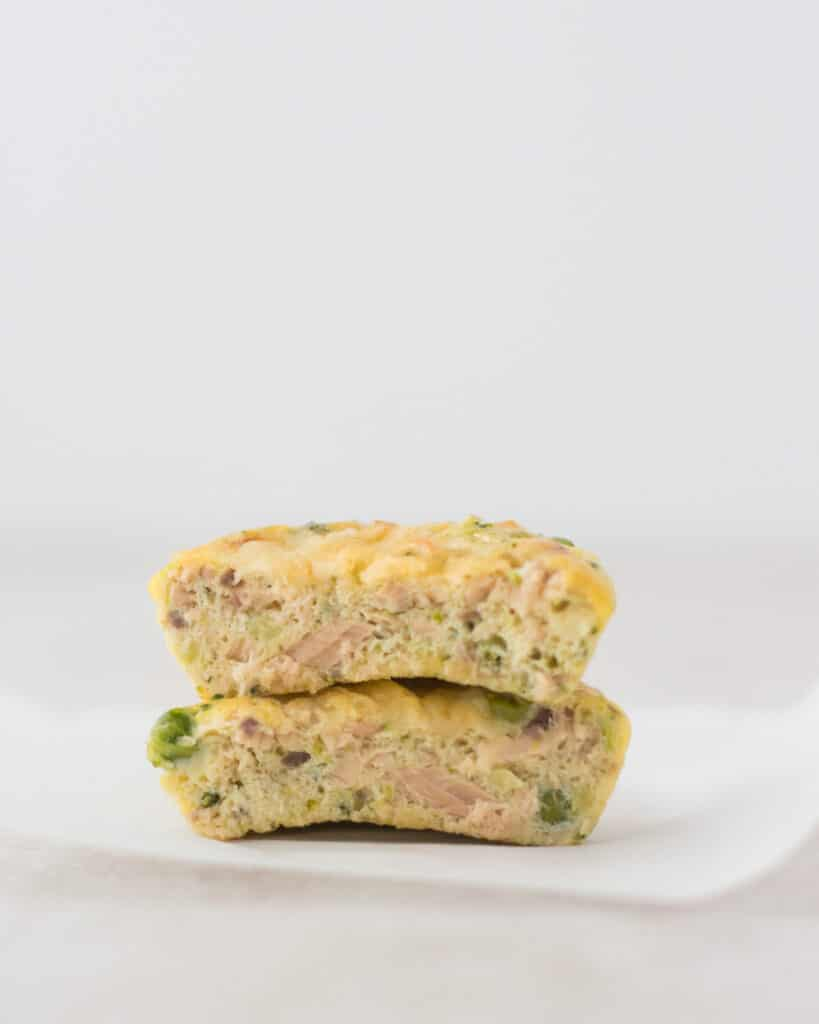 A close up shot of halved salmon quiche stacked