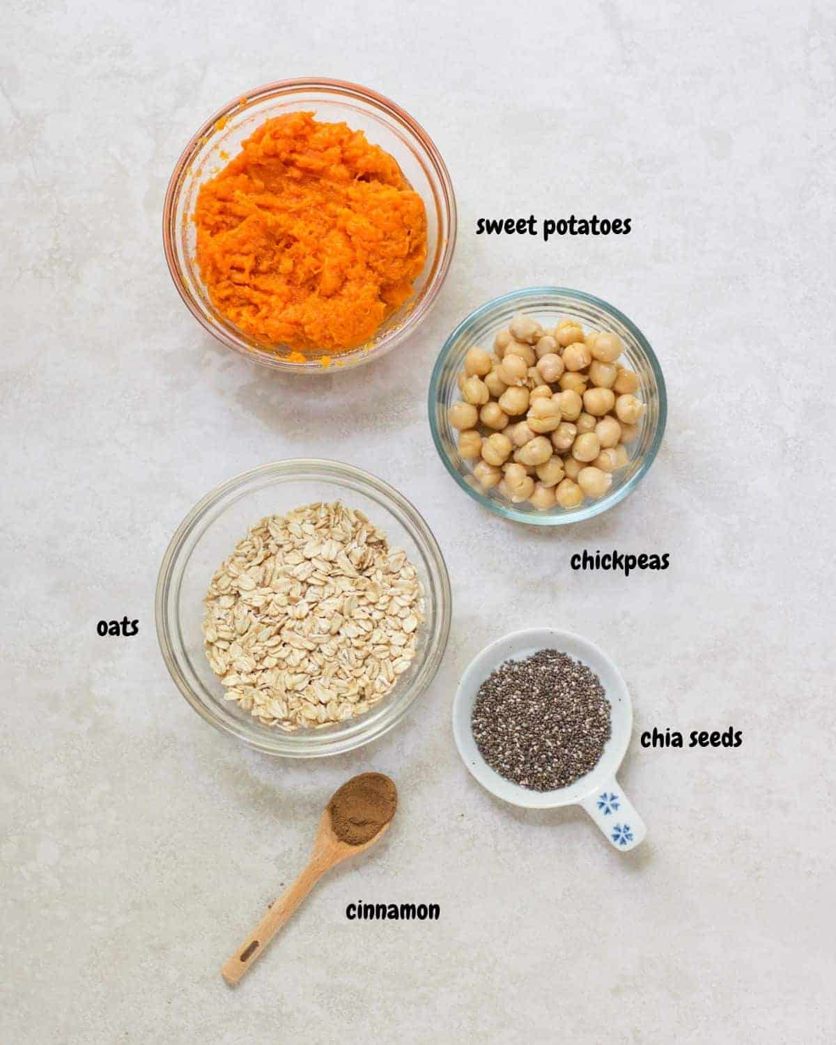 all the ingredients for the sweet potato chickpea cookies laid out on a white background