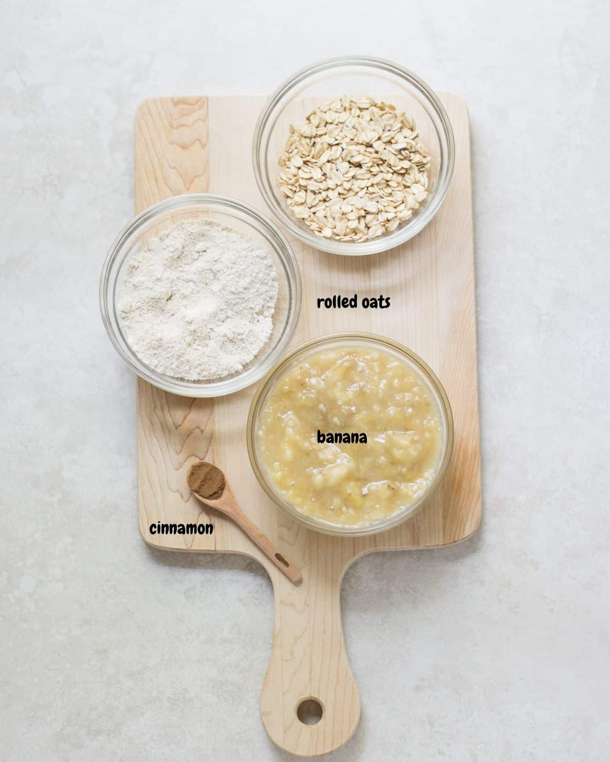 ingredients for the basic banana cookies on a wooden board