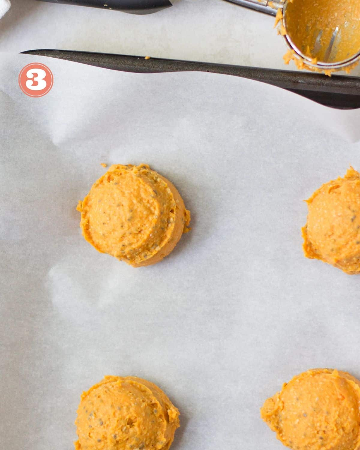 sweet potato cookies laid down on baking sheet with parchment paper before baking