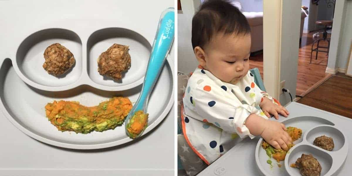 mashed sweet potato and avocado with meatballs on a sectioned plate and baby eating