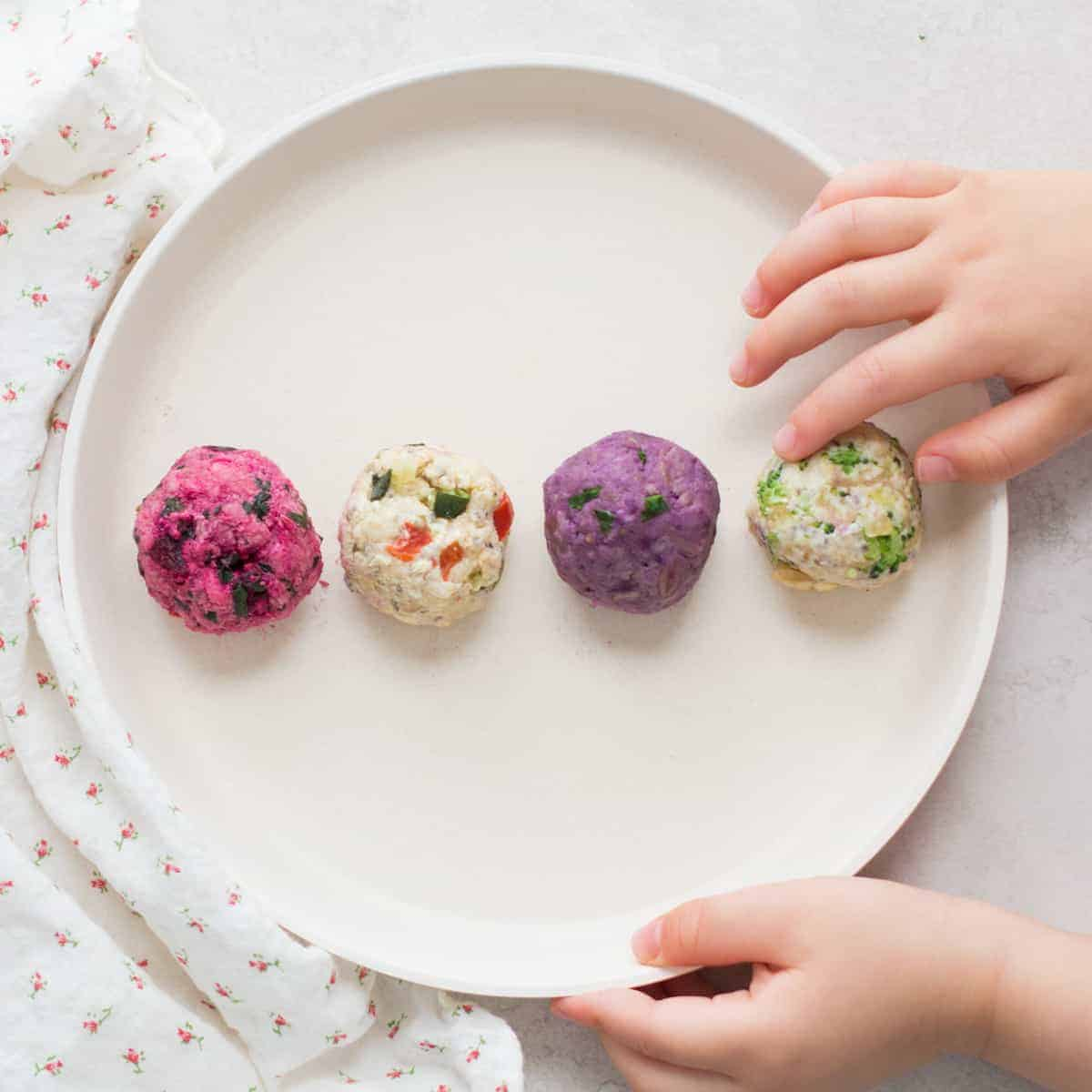 4 oatmeals shaped into balls and plated on a white plate