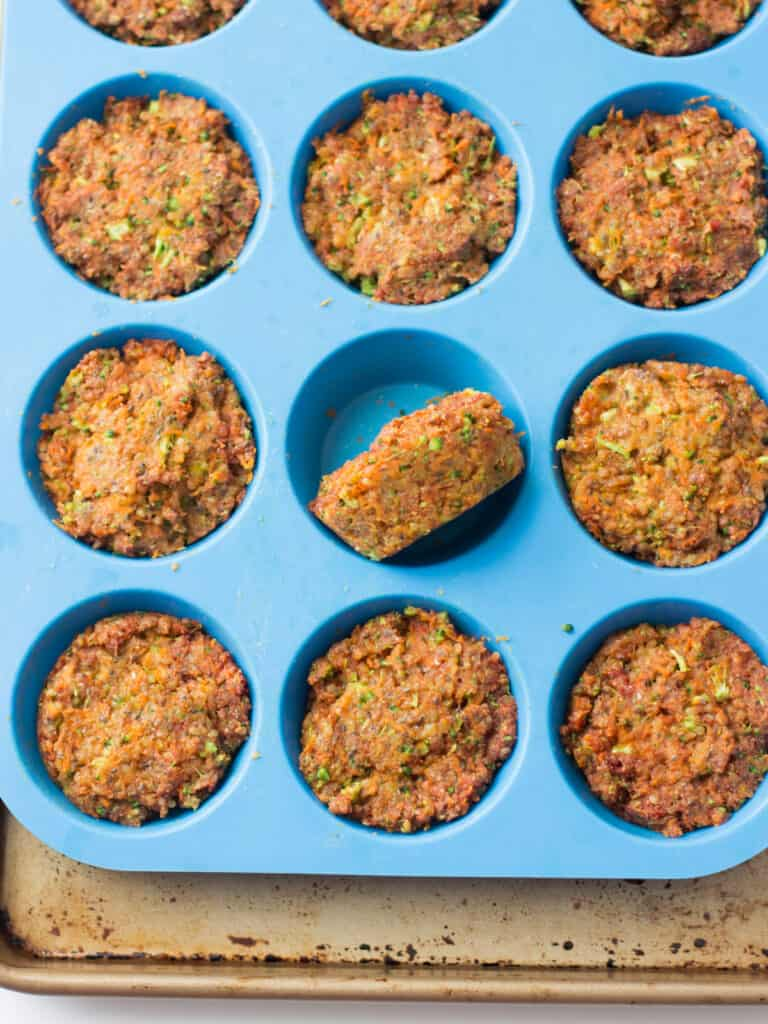 cooked vegetable muffins in blue silicone muffin pan