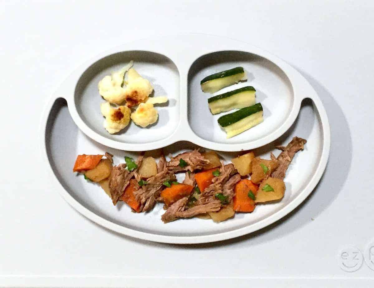 Pot roast with carrots, cauliflower, and zucchini