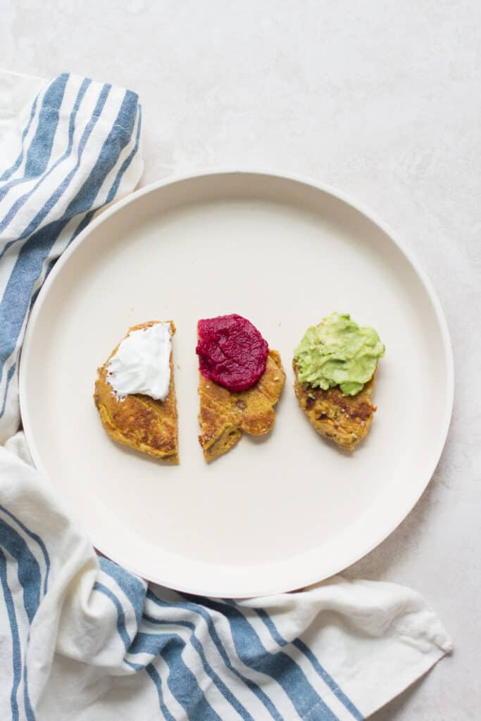 three strips of butternut squash pancakes each with different dips