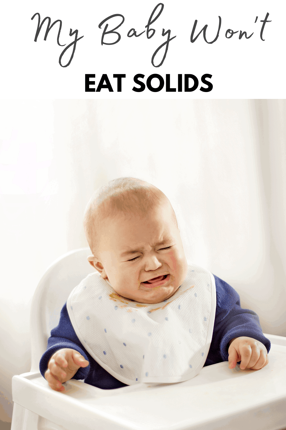 image of baby in high chair crying