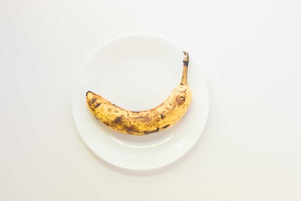 yellow banana with brown spots