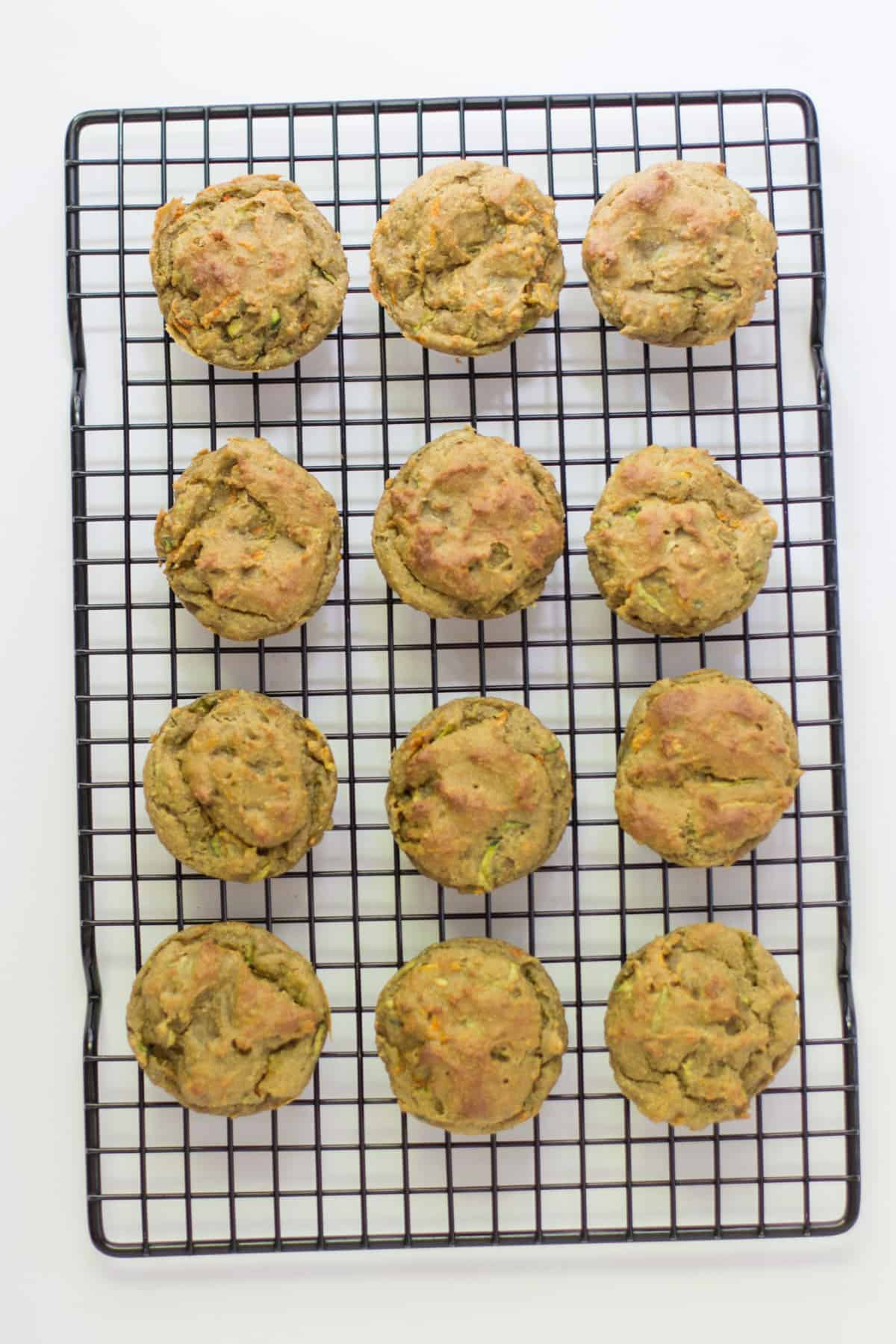 cooked avocado muffins on a cooling rack