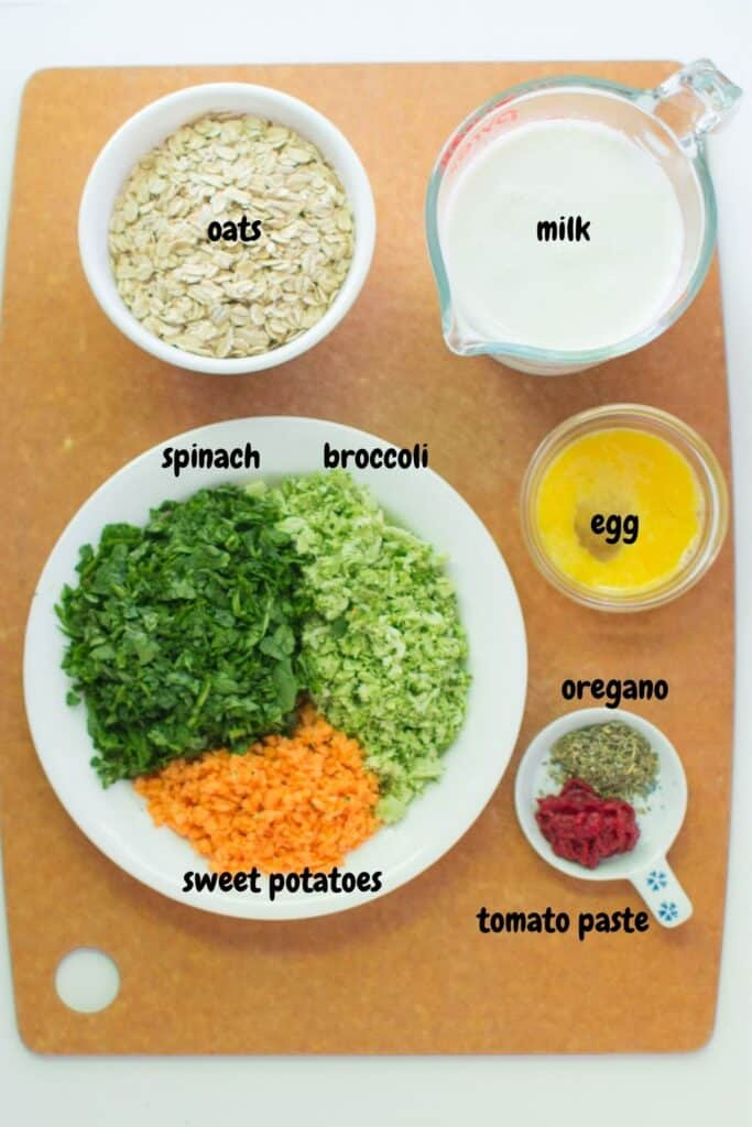 all the ingredients for making vegetable oats laid out on a wooden board